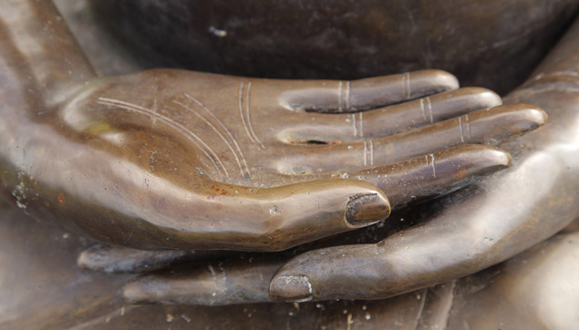 Buddha hands on a statue in Maui