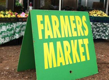 Farmers market sign on Maui
