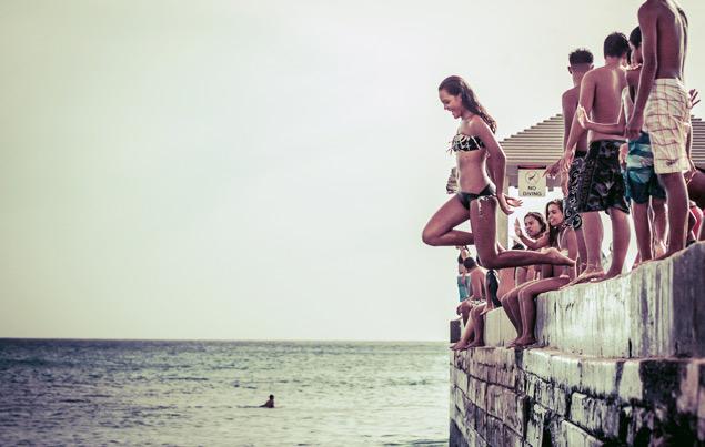 Jumping off the wall into the ocean —Hawaiian style fun